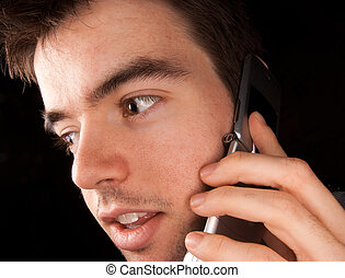 Young man talking on cell phone - Young man talking on a...