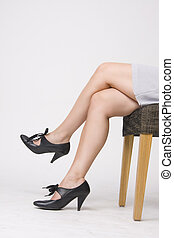 sexy shoes - woman in sexy shoes sitting on the chair