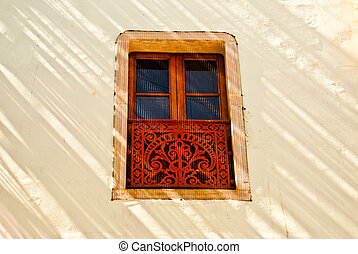 Decorative window in sunlight and shadow - Sunlight streaks...