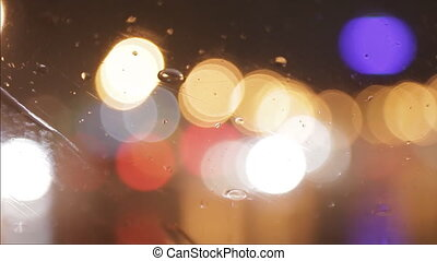 car window rain night background defocused in motion