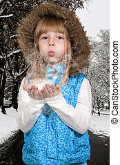Girl Blowing Snow - Beautiful little girl blowing snow off...