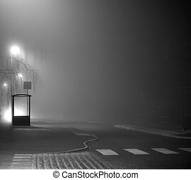 Bus stop - Rural empty buss shelter in dark foggy evening