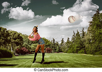 Baseball - attractive girl is playing baseball in a park