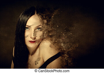 Dissolving woman - woman made of sand is dissolving in the...