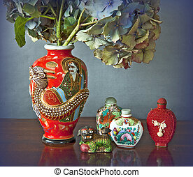 Still life: oriental vase with dragon and perfume bottles
