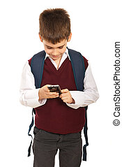 Schoolboy with phone mobile - Schoolboy sending message from...