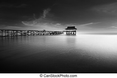 Lonely old pier at low tide - Evening low tide the sea from...