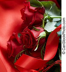 Red Roses bouquet over silk background. Valentine