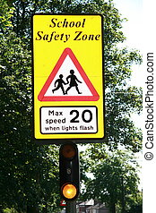 school safety zone sign - safety comes first so traffic must...