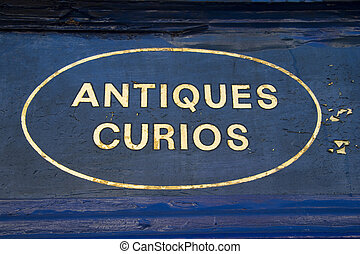Antiques and Curios - Weathered sign with gold leaf...