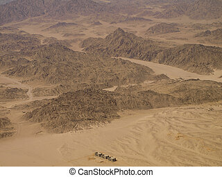Aerial View of three apartment buildings in the desert