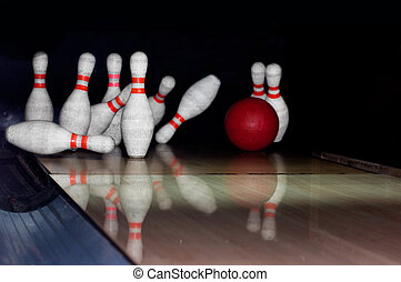 Bowling pins on wooden lane