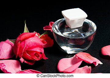 Red rose and rose oil essential. - Red rose over black....