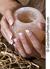 Woman%u2019s hand with French manicure holding exotic...
