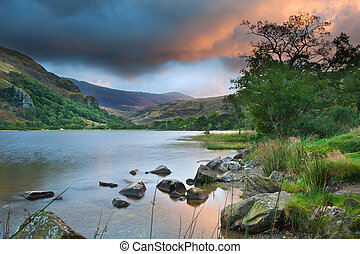 Beautiful sunrise over Llyn Gwynant in Snowdonia National...