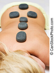 Hot volcanic stone therapy