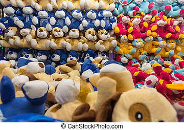 Stuffed animals inside a vending machine - Rows and rows of...