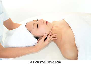 Smiling woman at massage spa