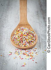 Sugar sprinkles - Colorful sugar sprinkles on a wooden spoon