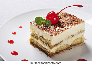 Tiramisu - Classical Dessert with Coffee on white plate...