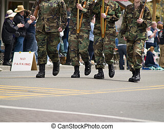 Marching Soldiers - A close up on marching soldiers in a...