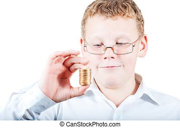 Boy holds a stack of coins