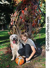Boy with his dog in the park - Little boy in the park with a...