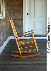 Rocking Chair - A rocking chair on the porch of a beach...