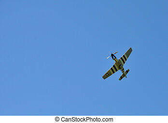 P-51 Mustang fighter with blue sky without clouds