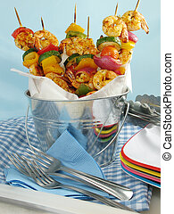 Bucket of Shrimp Kebabs - Shrimp kebabs with colorful bell...