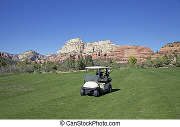 Cart on Fairway in Sedona - a cart sits on a fairway of a...