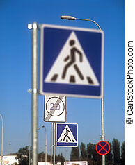 Traffic signs - Traffic signs against a clear blue sky