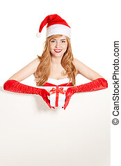 Young happy xmas woman holding gift. Blank for text