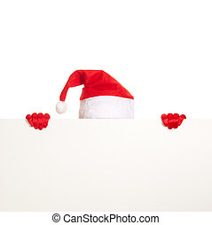 santas cap and hands in red gloves hold blank card on white...