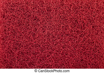 Red abrasive sponge texture background