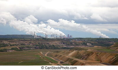 Thermal power plant against an open coal pit