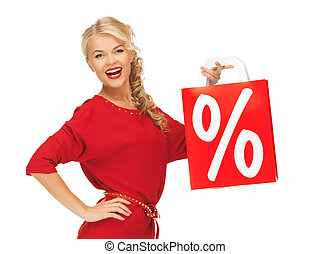 laughing woman in red dress with shopping bag - picture of...