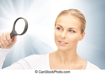 woman with magnifying glass - bright picture of woman with...