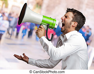 Portrait Of A Man Yelling Into A Megaphone