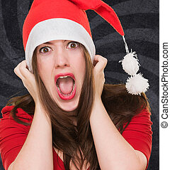 furious woman wearing a christmas hat against a vintage...