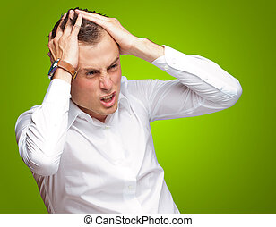 Portrait Of Stressed And Suffering Man On Green Background