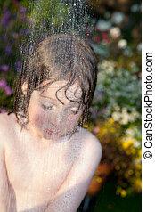 child hosepipe water summer garden splash