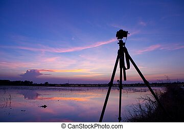 Camera shooting Time Lapse - Camera shooting on a tripod on...