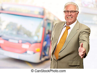 Senior Business Man Offering Handshake, Outdoor