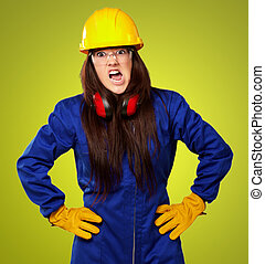 Woman Worker With Helmet On Green Background