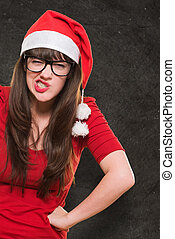 angry christmas woman wearing glasses against a grunge...