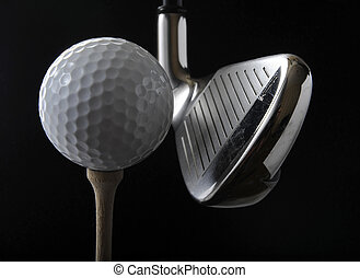 Golf club and ball - Golf club with ball on a tee in the...