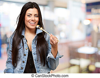 Woman Holding Chopstick Having Food