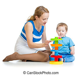 baby boy and mother playing togethe