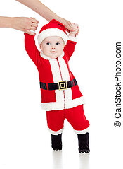 first steps of funny Santa claus baby